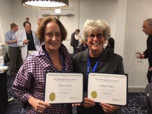 Thesia Garner and Kathleen Short holding their Roger Herriot Award certificates.