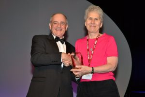 Wendy Martinez receiving Founders Award from American Statistical Association President Barry Nussbaum.