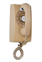 Beige wall phone with rotary dial